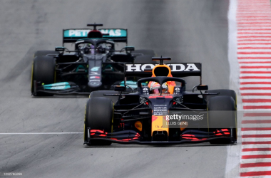 Red Bull's Dutch driver Max Verstappen drives ahead of Mercedes' British driver Lewis Hamilton during the Spanish Formula One Grand Prix race at the Circuit de Catalunya on May 9, 2021 in Montmelo on the outskirts of Barcelona. (Photo by LLUIS GENE / AFP) (Photo by LLUIS GENE/AFP via Getty Images)