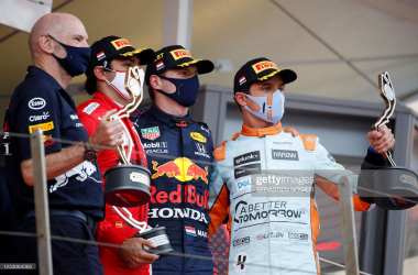 Second-placed Ferrari's Spanish driver Carlos Sainz Jr, winner Red Bull's Dutch driver Max Verstappen and third-placed McLaren's British driver Lando Norris celebrate with trophies during the podium ceremony after the Monaco Formula 1 Grand Prix, on May 23, 2021. (Photo by Sebastien Nogier / POOL / AFP)