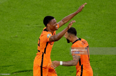 AMSTERDAM, NETHERLANDS - JUNE 13: Denzel Dumfries of Holland celebrates 3-2 with Memphis Depay of Holland during the EURO match between Holland v Ukraine at the Johan Cruijff Arena on June 13, 2021 in Amsterdam Netherlands (Photo by Laurens Lindhout/Soccrates/Getty Images)