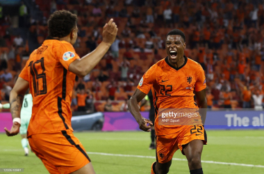 AMSTERDAM - (lr) Donyell Malen of Holland, Denzel Dumfries of Holland celebrate 2-0 during the UEFA EURO 2020 Group C match between the Netherlands and Austria at the Johan Cruijff ArenA on June 17, 2021 in Amsterdam, Netherlands. ANP MAURICE VAN STEEN (Photo by ANP Sport via Getty Images)