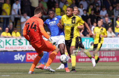 BURTON-UPON-TRENT, ENGLAND - JULY 24: Patson Daka of Leicester City in action with Michael Mancienne of Burton Albion during the Pre-Season friendly between Burton Albion and Leicester City at Pirelli Stadium on July 24, 2021 in Burton-upon-Trent, England. (Photo by Plumb Images/Leicester City FC via Getty Images)