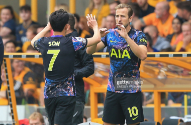 Tottenham Hotspur's English striker Harry Kane (R) comes on as a substitute for Tottenham Hotspur's South Korean striker Son Heung-Min (L) during the English Premier League football match between Wolverhampton Wanderers and Tottenham Hotspur at the Molineux stadium in Wolverhampton, central England on August 22, 2021.