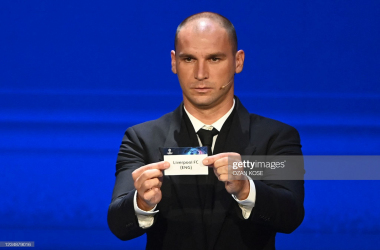 Serbian defender Branislav Ivanovic displays the slip showing the name of England's Liverpool during the draw for the UEFA Champions League football tournament in Istanbul on August 26, 2021. (Photo by OZAN KOSE / AFP) (Photo by OZAN KOSE/AFP via Getty Images)