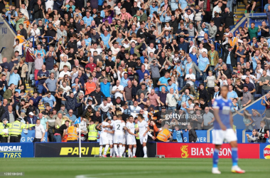 LEICESTER, ENGLAND - SEPTEMBER 11: Bernardo Silva of Manchester City celebrates with his team mates in front of the travelling Manchester City fans after scoring to make it 0-1 during the Premier League match between Leicester City and Manchester City at King Power Stadium on September 11, 2021 in Leicester, England. (Photo by Plumb Images/Leicester City FC via Getty Images)