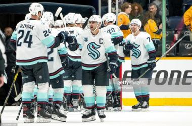 The Kraken celebrate their first-ever franchise win/Photo: John Russell/NHLI via Getty Images