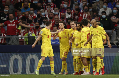 MADRID, SPAIN - OCTOBER 19: Mohamed Salah of Liverpool celebrates with his teammates after scoring a goal during UEFA Champions League Group B soccer match between Atletico Madrid and Liverpool at Wanda Metropolitano Stadium in Madrid, Spain on October 19, 2021. (Photo by Burak Akbulut/Anadolu Agency via Getty Images)