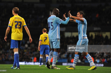 Mario Balotelli and Aleksandar Kolarov celebrate as Manchester City beat Birmingham City in 2011 | Michael Regan/Getty Images