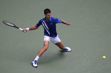 US Open: Novak Djokovic battles past Kyle Edmund to reach third round