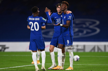 Kai Havertz of Chelsea (C) celebrates after scoring his sides fourth goal with teammates Callum Hudson-Odoi and Tammy Abraham during the Carabao Cup third round match between Chelsea and Barnsley at Stamford Bridge on September 23, 2020 in London, England. Football Stadiums around United Kingdom remain empty due to the Coronavirus Pandemic as Government social distancing laws prohibit fans inside venues resulting in fixtures being played behind closed doors. (Photo by Darren Walsh/Chelsea FC via Getty Images)
