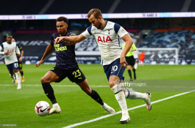 LONDON, ENGLAND - SEPTEMBER 27: Harry Kane of Tottenham Hotspur battles for possession with Jacob Murphy of Newcastle United during the Premier League match between Tottenham Hotspur and Newcastle United at Tottenham Hotspur Stadium on September 27, 2020 in London, England. Sporting stadiums around the UK remain under strict restrictions due to the Coronavirus Pandemic as Government social distancing laws prohibit fans inside venues resulting in games being played behind closed doors. (Photo by Clive Rose/Getty Images)