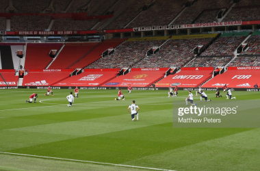 MANCHESTER, ENGLAND - OCTOBER 04: The two teams take a knee in support of the Black Lives Matter campaign ahead of the Premier League match between Manchester United and Tottenham Hotspur at Old Trafford on October 04, 2020 in Manchester, England. Sporting stadiums around the UK remain under strict restrictions due to the Coronavirus Pandemic as Government social distancing laws prohibit fans inside venues resulting in games being played behind closed doors. (Photo by Matthew Peters/Manchester United via Getty Images)