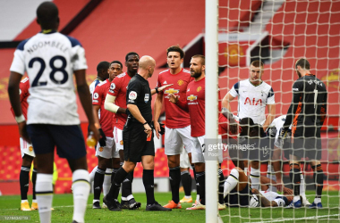 <div>MANCHESTER, ENGLAND - OCTOBER 04: Players of Manchester United confront Referee Anthony Taylor as he shows a red card to Anthony Martial of Manchester United during the Premier League match between Manchester United and Tottenham Hotspur at Old Trafford on October 04, 2020 in Manchester, England. Sporting stadiums around the UK remain under strict restrictions due to the Coronavirus Pandemic as Government social distancing laws prohibit fans inside venues resulting in games being played behind closed doors. (Photo by Oli Scarff - Pool/Getty Images)</div><div><br></div>