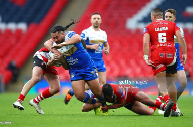 LONDON, ENGLAND - OCTOBER 17: Konrad Hurrell of Leeds Rhinos is tackled by Tyrone McCarthy of Salford Red Devils during the Coral Challenge Cup Final match between Leeds Rhinos and Salford Red Devils at Wembley Stadium on October 17, 2020 in London, England. Sporting stadiums around the UK remain under strict restrictions due to the Coronavirus Pandemic as Government social distancing laws prohibit fans inside venues resulting in games being played behind closed doors. (Photo by Michael Steele/Getty Images)