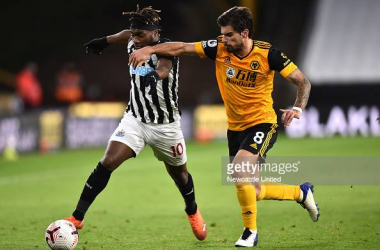 WOLVERHAMPTON, ENGLAND - OCTOBER 25: Allan Saint-Maximin of Newcastle United is challenged by Ruben Neves of Wolverhampton Wanderers during the Premier League match between Wolverhampton Wanderers and Newcastle United at Molineux on October 25, 2020 in Wolverhampton, England. Sporting stadiums around the UK remain under strict restrictions due to the Coronavirus Pandemic as Government social distancing laws prohibit fans inside venues resulting in games being played behind closed doors. (Photo by Newcastle United/Getty Images)