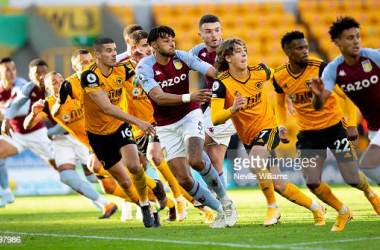 WOLVERHAMPTON, ENGLAND - DECEMBER 12: Tyrone Mings of Aston Villa in action during the Premier League match between Wolverhampton Wanderers and Aston Villa at Molineux on December 12, 2020 in Wolverhampton, England. The match will be played without fans, behind closed doors as a Covid-19 precaution. (Photo by Neville Williams/Aston Villa FC via Getty Images)