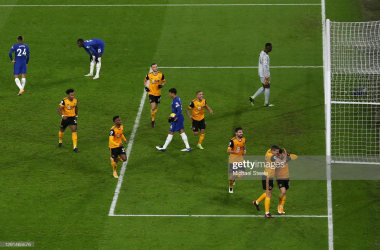 WOLVERHAMPTON, ENGLAND - DECEMBER 15: Pedro Neto of Wolves celebrates with teammate Conor Coady after scoring their sides second goal during the Premier League match between Wolverhampton Wanderers and Chelsea at Molineux on December 15, 2020 in Wolverhampton, England. The match will be played without fans, behind closed doors as a Covid-19 precaution. (Photo by Michael Steele/Getty Images)
