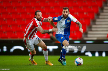 Bradley Johnson and Steven Fletcher compete for the ball  during Stoke's 1-0 win in December. (Photo by Malcolm Couzens/Getty Images)