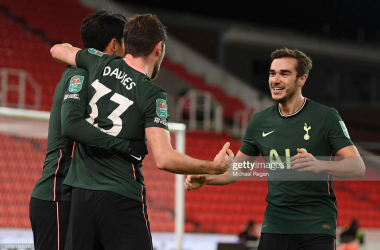 STOKE ON TRENT, ENGLAND - DECEMBER 23: Ben Davies of Tottenham Hotspur celebrates with team mates Heung-Min Son and Harry Winks (r) after scoring their sides second goal during the Carabao Cup Quarter Final match between Stoke City and Tottenham Hotspur at Bet365 Stadium on December 23, 2020 in Stoke on Trent, England. The match will be played without fans, behind closed doors as a Covid-19 precaution. (Photo by Michael Regan/Getty Images)