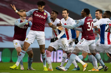 Wilfried Zaha of Crystal Palace and Tyrone Mings of Aston Villa clash during the Premier League match between Aston Villa and Crystal Palace at Villa Park on December 26, 2020 (Photo by Visionhaus)
