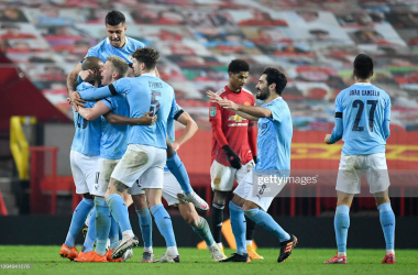 <div>MANCHESTER, ENGLAND - JANUARY 06: Fernandinho of Manchester City celebrates after scoring his teams second goal with his team mates during the Carabao Cup Semi Final match between Manchester United and Manchester City at Old Trafford on January 06, 2021 in Manchester, England. The match will be played without fans, behind closed doors as a Covid-19 precaution. (Photo by Peter Powell - Pool/Getty Images)</div>
