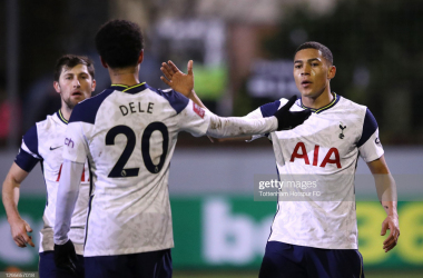 CROSBY, ENGLAND - JANUARY 10: Carlos Vinicius of Tottenham Hotspur celebrates with teammates Ben Davies and Dele Alli after scoring their team's first goal during the FA Cup Third Round match between Marine and Tottenham Hotspur at Rossett Park on January 10, 2021 in Crosby, England. Sporting stadiums around England remain under strict restrictions due to the Coronavirus Pandemic as Government social distancing laws prohibit fans inside venues resulting in games being played behind closed doors. (Photo by Tottenham Hotspur FC/Tottenham Hotspur FC via Getty Images)