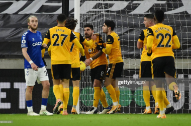 WOLVERHAMPTON, ENGLAND - JANUARY 12: Ruben Neves of Wolverhampton Wanderers celebrates with team mates after scoring their team's first goal during the Premier League match between Wolverhampton Wanderers and Everton at Molineux on January 12, 2021 in Wolverhampton, England. Sporting stadiums around England remain under strict restrictions due to the Coronavirus Pandemic as Government social distancing laws prohibit fans inside venues resulting in games being played behind closed doors. (Photo by Rui Vieira - Pool/Getty Images)