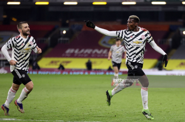 BURNLEY, ENGLAND - JANUARY 12: Paul Pogba of Manchester United celebrates after scoring their team's first goal during the Premier League match between Burnley and Manchester United at Turf Moor on January 12, 2021 in Burnley, England. Sporting stadiums around England remain under strict restrictions due to the Coronavirus Pandemic as Government social distancing laws prohibit fans inside venues resulting in games being played behind closed doors. (Photo by Clive Brunskill/Getty Images)