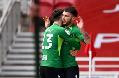 Scott Hogan of Birmingham City celebrates with teammate Jon Toral after scoring his team's first goal during the Sky Bet Championship match between Middlesbrough and Birmingham City at Riverside Stadium on January 16, 2021 in Middlesbrough, England. Sporting stadiums around the UK remain under strict restrictions due to the Coronavirus Pandemic as Government social distancing laws prohibit fans inside venues resulting in games being played behind closed doors. (Photo by Stu Forster/Getty Images)