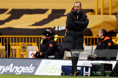 WOLVERHAMPTON, ENGLAND - JANUARY 16: Nuno Espirito Santo, Manager of Wolverhampton Wanderers looks on during the Premier League match between Wolverhampton Wanderers and West Bromwich Albion at Molineux on January 16, 2021 in Wolverhampton, England. Sporting stadiums around England remain under strict restrictions due to the Coronavirus Pandemic as Government social distancing laws prohibit fans inside venues resulting in games being played behind closed doors. (Photo by Adrian Dennis - Pool/Getty Images)