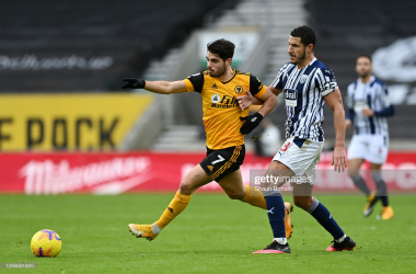 Pedro Neto of Wolverhampton Wanderers is challenged by Jake Livermore of West Bromwich Albion during the Premier League match between Wolverhampton Wanderers and West Bromwich Albion at Molineux on January 16, 2021 in Wolverhampton, England. Sporting stadiums around England remain under strict restrictions due to the Coronavirus Pandemic as Government social distancing laws prohibit fans inside venues resulting in games being played behind closed doors. (Photo by Shaun Botterill/Getty Images)