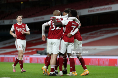 LONDON, ENGLAND - JANUARY 18: Pierre-Emerick Aubameyang of Arsenal (R) celebrates with teammates (L-R) Kieran Tierney, Alexandre Lacazette, Emile Smith Rowe and Bukayo Saka after scoring their team's first goal during the Premier League match between Arsenal and Newcastle United at Emirates Stadium on January 18, 2021 in London, England. Sporting stadiums around England remain under strict restrictions due to the Coronavirus Pandemic as Government social distancing laws prohibit fans inside venues resulting in games being played behind closed doors. (Photo by Catherine Ivill/Getty Images)