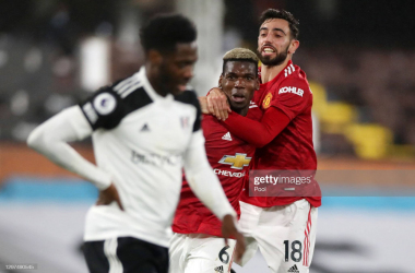 <div>LONDON, ENGLAND - JANUARY 20: Paul Pogba of Manchester United celebrates with team mate Bruno Fernandes of Manchester United after scoring their side's second goal during the Premier League match between Fulham and Manchester United at Craven Cottage on January 20, 2021 in London, England. Sporting stadiums around the UK remain under strict restrictions due to the Coronavirus Pandemic as Government social distancing laws prohibit fans inside venues resulting in games being played behind closed doors. (Photo by Peter Cziborra - Pool/Getty Images)</div><div><br></div>