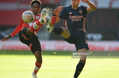 SOUTHAMPTON, ENGLAND - JANUARY 23: Gabriel Martinelli of Arsenal challenges Kyle Walker-Peters of Southampton for the ball during the FA Cup 4th round match between Southampton and Arsenal on January 23, 2021 in Southampton, England. Sporting stadiums around the UK remain under strict restrictions due to the Coronavirus Pandemic as Government social distancing laws prohibit fans inside venues resulting in games being played behind closed doors. (Photo by David Price/Arsenal FC via Getty Images)