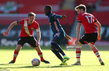 <div>Southampton v Arsenal: The Emirates FA Cup Fourth Round</div><div><br></div><div>SOUTHAMPTON, ENGLAND - JANUARY 23: Nicolas Pepe of Arsenal is challenged by James Ward-Prowse (L) and Stuart Armstrong (R) of Southampton during The Emirates FA Cup Fourth Round match between Southampton FC and Arsenal FC on January 23, 2021 in Southampton, England. Sporting stadiums around the UK remain under strict restrictions due to the Coronavirus Pandemic as Government social distancing laws prohibit fans inside venues resulting in games being played behind closed doors. (Photo by Catherine Ivill/Getty Images)</div>