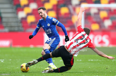 <div>BRENTFORD, ENGLAND - JANUARY 24: James Maddison of Leicester City looks to break past Vitaly Janelt of Brentford during The Emirates FA Cup Fourth Round match between Brentford and Leicester City at Brentford Community Stadium on January 24, 2021 in Brentford, England. Sporting stadiums around the UK remain under strict restrictions due to the Coronavirus Pandemic as Government social distancing laws prohibit fans inside venues resulting in games being played behind closed doors. (Photo by Clive Rose/Getty Images)</div>