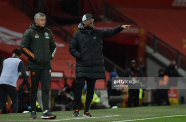 MANCHESTER, ENGLAND - JANUARY 24: ( THE SUN OUT,THE SUN ON SUNDAY OUT ) Jurgen Klopp manager of Liverpool with Manchester United manager Ole Gunnar Solskjaer during The Emirates FA Cup Fourth Round match between Manchester United and Liverpool at Old Trafford on January 24, 2021 in Manchester, England. Sporting stadiums around the UK remain under strict restrictions due to the Coronavirus Pandemic as Government social distancing laws prohibit fans inside venues resulting in games being played behind closed doors. (Photo by John Powell/Liverpool FC via Getty Images)