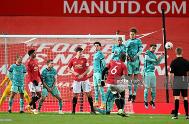 <div>MANCHESTER, ENGLAND - JANUARY 24: Paul Pogba of Manchester United shoots from a free kick over Curtis Jones, Fabinho, Rhys Williams and Roberto Firminho of Liverpool during The Emirates FA Cup Fourth Round match between Manchester United and Liverpool at Old Trafford on January 24, 2021 in Manchester, England. Sporting stadiums around the UK remain under strict restrictions due to the Coronavirus Pandemic as Government social distancing laws prohibit fans inside venues resulting in games being played behind closed doors. (Photo by Michael Regan - The FA/The FA via Getty Images)</div><div><br></div>