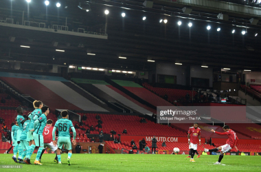 MANCHESTER, ENGLAND - JANUARY 24: Bruno Fernandes of Manchester United scores their side's third goal from a free kick during The Emirates FA Cup Fourth Round match between Manchester United and Liverpool at Old Trafford on January 24, 2021 in Manchester, England. Sporting stadiums around the UK remain under strict restrictions due to the Coronavirus Pandemic as Government social distancing laws prohibit fans inside venues resulting in games being played behind closed doors. (Photo by Michael Regan - The FA/The FA via Getty Images)
