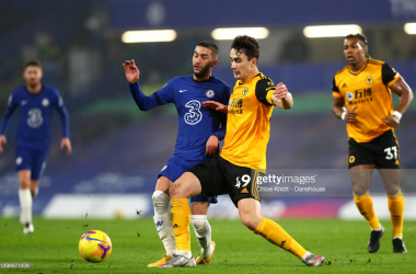 Hakim Ziyech of Chelsea FC and Max Kilman of Wolverhampton Wanderers in action during the Premier League match between Chelsea and Wolverhampton Wanderers at Stamford Bridge on January 27, 2021 in London, England. Sporting stadiums around the UK remain under strict restrictions due to the Coronavirus Pandemic as Government social distancing laws prohibit fans inside venues resulting in games being played behind closed doors. (Photo by Chloe Knott - Danehouse/Getty Images)