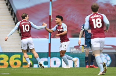 BIRMINGHAM, ENGLAND - FEBRUARY 06: Ollie Watkins of Aston Villa celebrates with team mate Jack Grealish after scoring their side's first goal during the Premier League match between Aston Villa and Arsenal at Villa Park on February 06, 2021 in Birmingham, England. Sporting stadiums around the UK remain under strict restrictions due to the Coronavirus Pandemic as Government social distancing laws prohibit fans inside venues resulting in games being played behind closed doors. (Photo by Shaun Botterill/Getty Images)