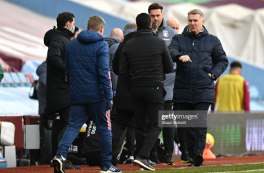 BIRMINGHAM, ENGLAND - FEBRUARY 06: Dean Smith, Manager of Aston Villa and Mikel Arteta, Manager of Arsenal interact after the Premier League match between Aston Villa and Arsenal at Villa Park on February 06, 2021 in Birmingham, England. Sporting stadiums around the UK remain under strict restrictions due to the Coronavirus Pandemic as Government social distancing laws prohibit fans inside venues resulting in games being played behind closed doors. (Photo by Shaun Botterill/Getty Images)
