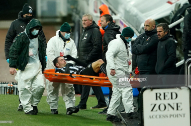 NEWCASTLE UPON TYNE, ENGLAND - FEBRUARY 06: Fabian Schar of Newcastle United goes off injured on a stretcher during the Premier League match between Newcastle United and Southampton at St. James Park on February 06, 2021 in Newcastle upon Tyne, England. Sporting stadiums around the UK remain under strict restrictions due to the Coronavirus Pandemic as Government social distancing laws prohibit fans inside venues resulting in games being played behind closed doors. (Photo by Owen Humphreys - Pool/Getty Images)