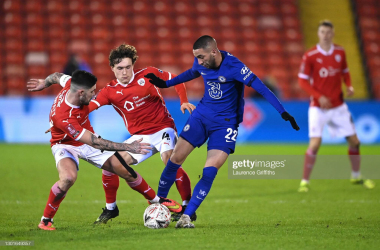 Callum Styles and Alex Mowatt of Barnsley battle with Hakim Ziyech of Chelsea during The Emirates FA Cup Fifth Round match between Barnsley and Chelsea at Oakwell Stadium on February 11, 2021 in Barnsley, England. (Photo by Laurence Griffiths/Getty Images)
