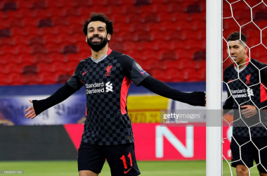 BUDAPEST, HUNGARY - FEBRUARY 16: Mohamed Salah of Liverpool celebrates after scoring their side's first goal during the UEFA Champions League Round of 16 match between RB Leipzig and Liverpool FC at Puskas Arena on February 16, 2021 in Budapest, Hungary. Liverpool face RB Leipzig at a neutral venue in Budapest behind closed doors after Germany imposed a ban on travellers arriving from the UK in an effort to prevent the spread of Covid-19 variants. (Photo by Laszlo Szirtesi/Getty Images)