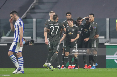 TURIN, ITALY - FEBRUARY 18: Bruno Fernandes of Manchester United celebrates with team mates after scoring to give the side a 1-0 lead during the UEFA Europa League Round of 32 match between Real Sociedad and Manchester United at Allianz Stadium on February 18, 2021 in Turin, Italy. (Photo by Jonathan Moscrop/Getty Images)