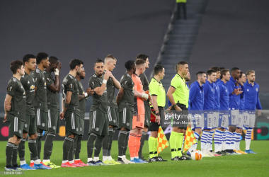 TURIN, ITALY - FEBRUARY 18: Players and officials line up prior to kick off in the UEFA Europa League Round of 32 match between Real Sociedad and Manchester United at Allianz Stadium on February 18, 2021 in Turin, Italy. (Photo by Jonathan Moscrop/Getty Images)