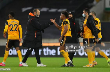 WOLVERHAMPTON, ENGLAND - FEBRUARY 19: Nuno Espirito Santo, Manager of Wolverhampton Wanderers embraces Adama Traore of Wolverhampton Wanderers at full-time after the Premier League match between Wolverhampton Wanderers and Leeds United at Molineux on February 19, 2021 in Wolverhampton, England. Sporting stadiums around the UK remain under strict restrictions due to the Coronavirus Pandemic as Government social distancing laws prohibit fans inside venues resulting in games being played behind closed doors. (Photo by Catherine Ivill/Getty Images)