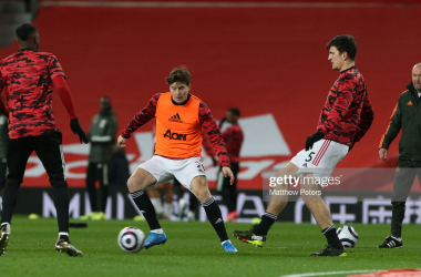 Harry Maguire (right), Victor Lindelof (middle) and Aaron Wan Bissaka (left) warm-up in preparation for the clash against Newcastle United on February 21st. (Photo by Matthew Peters - Getty Images)