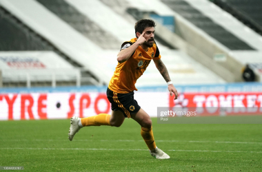 NEWCASTLE UPON TYNE, ENGLAND - FEBRUARY 27: Ruben Neves of Wolverhampton Wanderers celebrates after scoring their side's first goal during the Premier League match between Newcastle United and Wolverhampton Wanderers at St. James Park on February 27, 2021 in Newcastle upon Tyne, England. Sporting stadiums around the UK remain under strict restrictions due to the Coronavirus Pandemic as Government social distancing laws prohibit fans inside venues resulting in games being played behind closed doors. (Photo by Owen Humphreys - Pool/Getty Images)