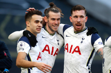 <div>LONDON, ENGLAND - FEBRUARY 28: Gareth Bale (C) of Tottenham Hotspur celebrates with team mates (L - R) Sergio Reguilon and Pierre-Emile Hojbjerg after scoring their side's fourth goal during the Premier League match between Tottenham Hotspur and Burnley at Tottenham Hotspur Stadium on February 28, 2021 in London, England. Sporting stadiums around the UK remain under strict restrictions due to the Coronavirus Pandemic as Government social distancing laws prohibit fans inside venues resulting in games being played behind closed doors. (Photo by Matthew Childs - Pool/Getty Images)</div><div><br></div>